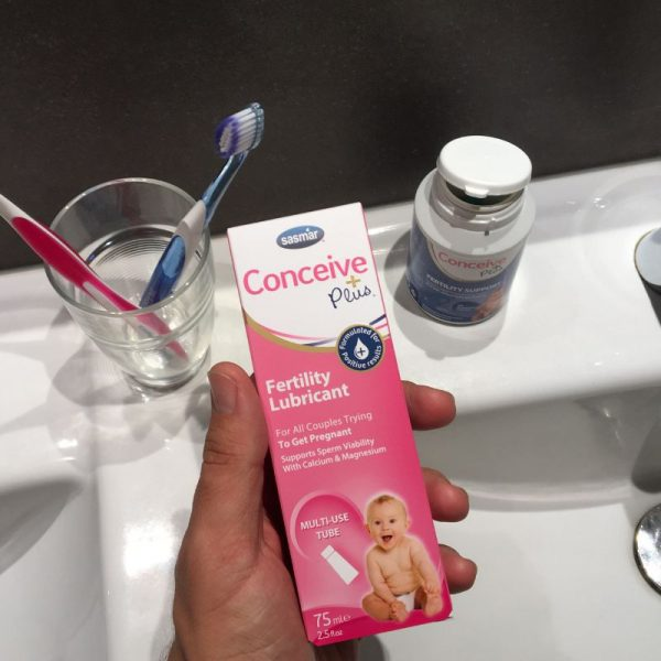 Holding personal lubricant in bathroom trying to get pregnant lube